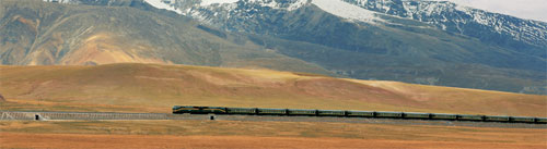 The Tangula luxury train traveling through the Uninhabitable yet beautiful landscape of Tibet.
