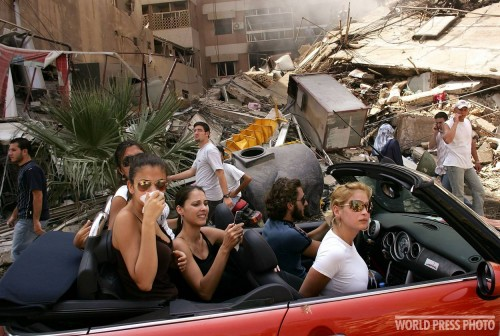 Young rich hipsters drive through Beirut surveying the damage of the bombings