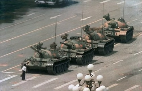 Unknown man brings a row of tanks to a stop during student uprising
