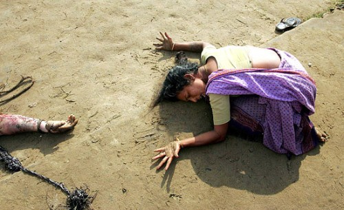 A woman mourning the death of a relative after being hit by a tsunami