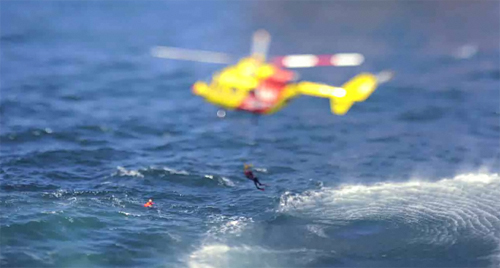Tilt shift stop motion video of a helicopter rescue mission at sea